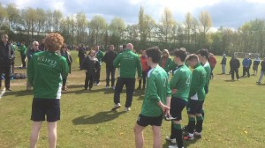 Manager Paul Moore speaks to the players, parents and supporters after the game