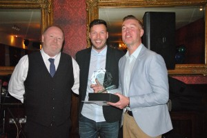 2nds Team Captain Neil Young accepts the Manager's Player of the Year Award on behalf of the winner Paul O'Reilly