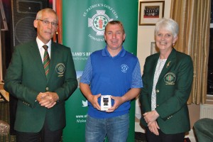 Stephen Galbraith (centre) is presented with his prize by St Patrick Golf Club Captains Brendan Mullen & Elizabeth Mageean