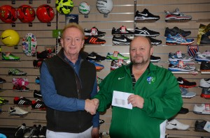Paul McCartan from McCartan Sports Downpatrick presents Downpatrick FC's Thomas Leckey with a sponsorship cheque