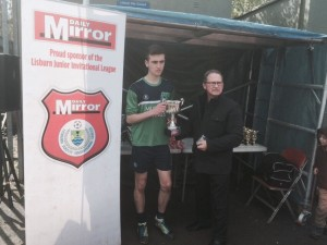 16's Captain Callum Shields receives the runners-up Trophy from League Chairman Stanley Sheppard