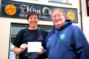 Kim from Kim On In, Downpatrick presents a cheque to Eugene Milligan