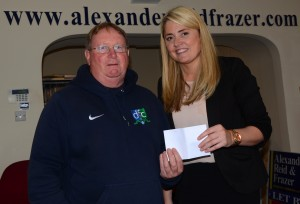 Secretary Eugene Milligan receives a sponsorship cheque from Mary-Lou Press the manager of Alexander, Reid & Frazer Estate Agents, Downpatrick.
