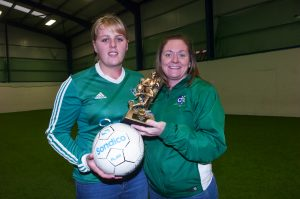 Kyla Trainor of Downpatrick Ladies FC receives the NIWFA player of the season award from team coach Michelle Madine.